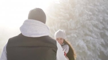 Cute Young Couple Christmas Outdoors Present Joy Hugging — Stock Video