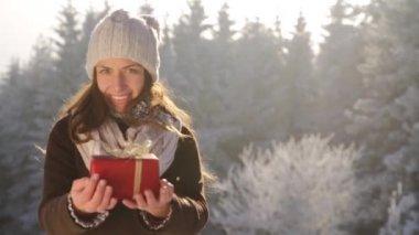 Pretty Woman Holding Present Winter Seasonal Background — Stock Video