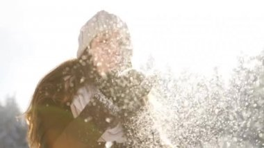 Attractive Young Woman Blowing Snow Flakes At Camera Sun Flare — Stock Video