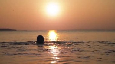 Man Swimming at Sunset Background HD — Stock Video
