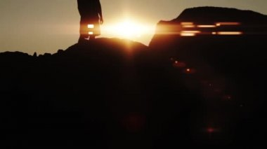 Sun Lens Flare Silhouette Man Victory Pose HD — Stockvideo