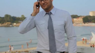 Young Man Tie Talking on Phone Beach Vacation Concept HD — Stock Video