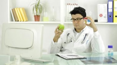 Young Doctor Choosing Pills Over Fruit Medicine Concept — Stock Video
