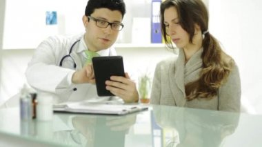Healthcare Technology Young Doctor Using Tablet to Show Patient — Stock Video