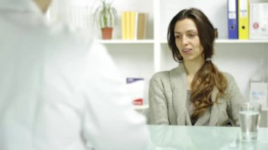 Young Female Talking to Doctor Medical Practitioner Smiling — Stock Video