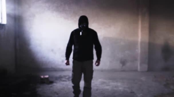 depositphotos_72409245-stock-video-dangerous-man-in-gas-mask.jpg