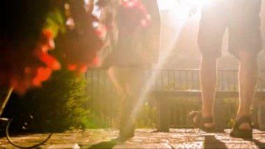 Romance Love Romantic Couple Man Woman Holiday Vacation Travel Europe Flower Garden Sitting Silhouette Sunset Lens Flare Uhd — Stock Video