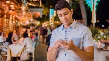 Handsome Young Professional Businessman Tourist Tourism Typing On Smartphone Tablet 3G 4G App Communication Social Network Travel Destination Escape Getaway Technology Tech Savvy Intelligent Confident Urban Setting Uhd 4K — Stock Video