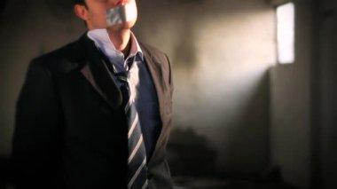 Businessman taken hostage — Stock Video