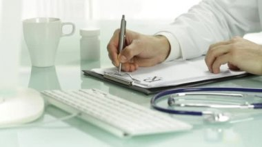 Doctor writing on rx prescription blank — Stock Video