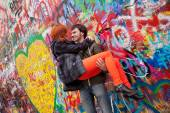 Young couple on the Background John Lennon Wall, Prague — Stock Photo