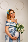 Young pregnant woman in fashionable dress — Stock Photo