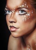 Girl with makeup deer — Stock Photo