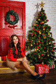 Cute girl is in Christmas interior — Stock Photo