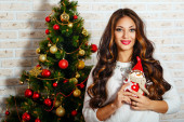Cute girl is in Christmas interior — Foto de Stock