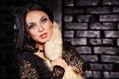 Girl in a black dress and furs — Stock fotografie