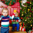 Little brother and sister near Christmas tree — 图库照片 #60759665