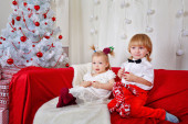 Brother and sister awaiting Christmas — Stock Photo