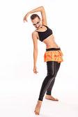 Girl with clown makeup dances — Stock Photo