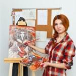 Artist paints picture — Stock Photo #65006399