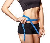 Girl measuring waist — Stock Photo