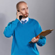 Businessman talking on cell phone — Stock Photo #66842579