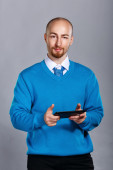 Businessman holding a tablet PC — Stock Photo