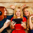 Sisters make fun selfie, listening to music on headphones — Stock Photo #68962953