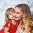 Mother and daughter hugging — Stock Photo #69199189