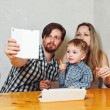 Family mother, father and son are doing selfie — Stock Photo #69829415