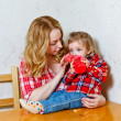 Mom gives daughter drink from a bottle — Stock Photo #69829119