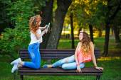 Best friends are photographed in park. — Stock Photo