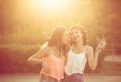 Best girlfriends hug. Sunset. — Stock Photo