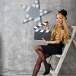 Girl director with clapperboard — Stock Photo #80666002