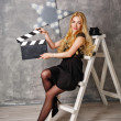Girl director with an empty clapperboard — Stock Photo #80834544