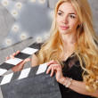 Portrait of a girl director with an empty clapperboard — Stock Photo #80904790