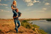 Couple in love. Man carrying girl on piggyback. — Stock Photo