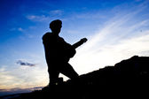 Silhouette guitar player  — Photo