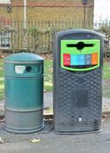 Dustbins outside against brick wall — Stock Photo