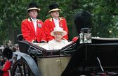 LONDON - JUNE 13: Queen Elizabeth II and Prince Philip seat on the Royal Coach at Queen's Birthday Parade, also known as Trooping the Colour, on June 13, 2015 in London, England. — Stock Photo