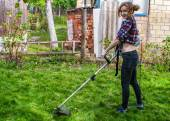 Woman in Plaid Shirt Mowing Lawn — Stock Photo