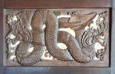 Wood carving of nagas — Stock Photo