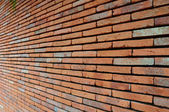 Perspective of red brick wall — Stock Photo