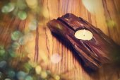 Candle in wooden holder — Stock Photo