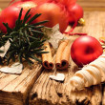 Red christmas ball and birch bark hearts — Stock Photo #58143379