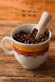 View on cup full of coffee beans — Stock Photo