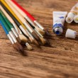 Opened blue acrylic color and set of paintbrushes — Stock Photo #66185477