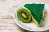 Green jelly cake and kiwi fruit on one plate — Stock Photo