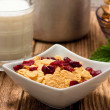 Bowl full of cornflakes with cranberries — Stock Photo #72352351