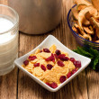 Bowl with cornflakes mixed with cranberies and dried apples — Stock Photo #72875573